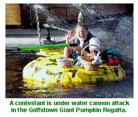 Contestants come under fire by water cannon in the Goffstown Giant Pumpkin Regatta.